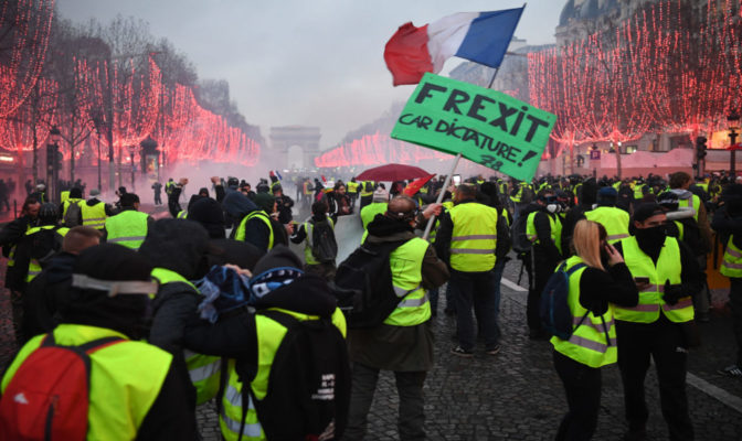 "2018-12-08 17:10:56 Protestors wearing ""yellow vests"" (Gilets jaunes) stand on the Champs Elysees avenue in Paris on December 8, 2018 during a protest against rising costs of living they blame on high taxes. Paris was on high alert on December 8 with major security measures in place ahead of fresh ""yellow vest"" protests which authorities fear could turn violent for a second weekend in a row. Eric FEFERBERG / AFP"